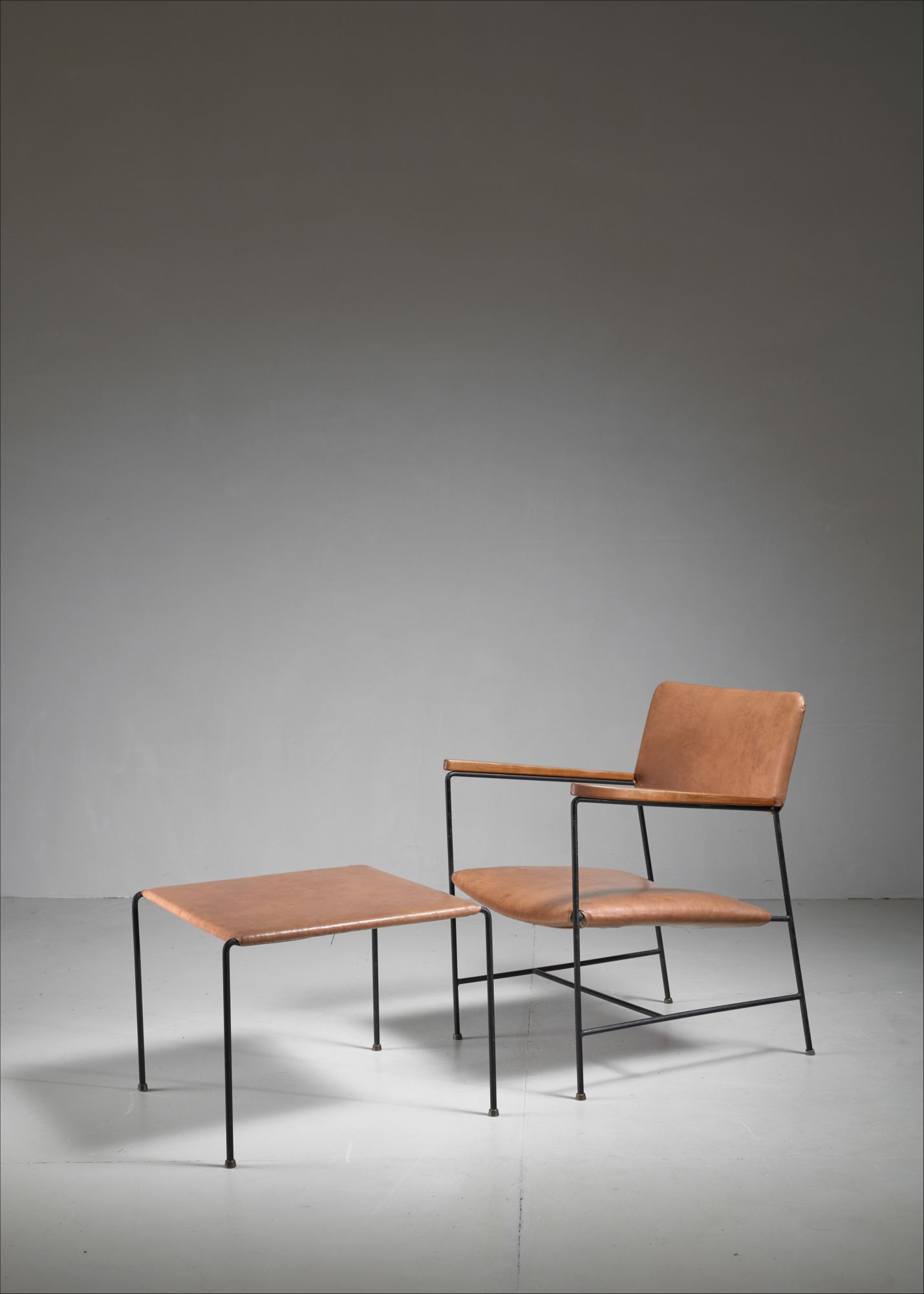 & Arden Riddle Iron and Naugahyde Chair with Ottoman USA 1960s